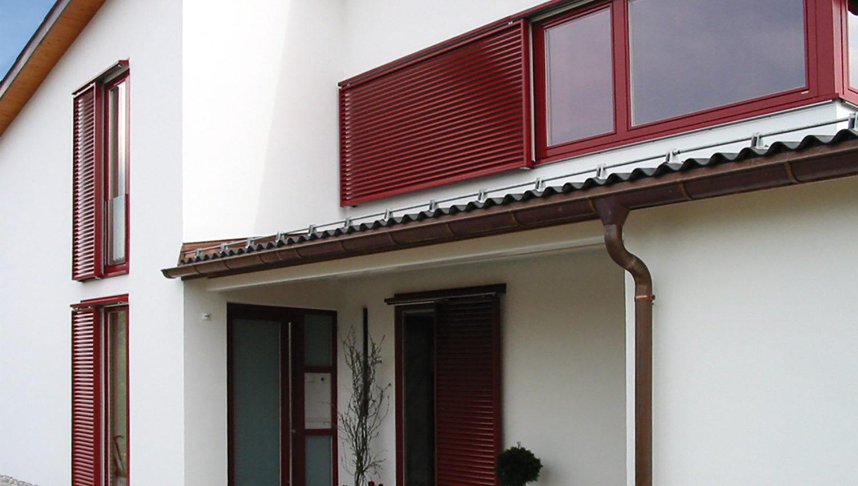 Volets coulissants sur une façade